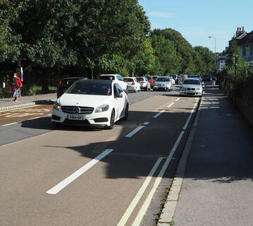 short stretch of cycle lane with single yellow line